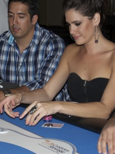 Poker professional Tiffany Michelle playing at the Custom Storage sponsored table at Aces and Bases